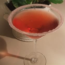 Cosmopolitan Recipe - Vodka, cointreau and cranberry juice with a splash of lime. Shaken not stirred.