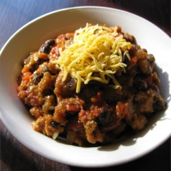 Slow Cooker Pumpkin Turkey Chili Recipe - Ground turkey, pumpkin, and easy chili ingredients like seasoned black beans combine in a flavorful and surprisingly light chili that's made in the slow cooker.