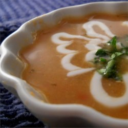 Mulligatawny Soup III Recipe - If you like a less spicy Mulligatawny, this recipe is for you.  You will need to have five cups of White Stock on hand (see White Stock recipe), as well as carrots, celery, green pepper, onion, chicken, chopped apple, and rice.