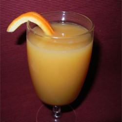 Triple Fruit Drink Recipe - A refreshing beverage made with orange juice, apricot nectar, and a splash of lemon.