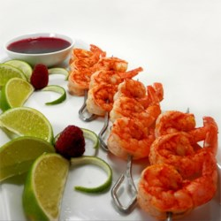 Butterfly Chili Lime Prawn Spedini with Raspberry Dipping Sauce Recipe - A fun citrus and spice twist on a beautifully butterflied prawn.