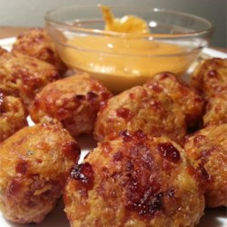 Easy Sausage Cheese Balls Recipe - The best part of breakfast--biscuit mix, cheddar and ground sausage--are formed into no-fuss balls that you bake in the oven.