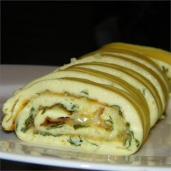 Baked Omelet Roll Recipe - This omelet is so easy and delicious.  It bakes in the oven, so there is no watching the stove.  My son loves to make it for us.