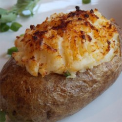 Chef John's Twice-Baked Potatoes Recipe and Video - When entertaining guests on special occasions, don't forget that you're putting on a show with the food. And, when it comes to starchy side dishes, these potatoes are a great way to express flair for the dramatic.