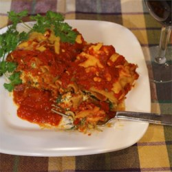 Lighter Simple Lasagna Roll Ups Recipe - Delightful lasagna rolls filled with three cheeses and ground turkey are on the lighter side, thanks to the use of low-fat ingredients.