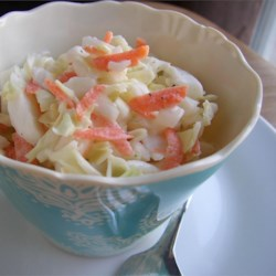 Aw-some Coleslaw Recipe and Video - Toss crispy cabbage, vibrant carrots, and sweet onion in a creamy sweet-and-sour dressing for restaurant-style cole slaw at home.