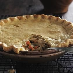 Deep-Dish Chicken Pot Pie Recipe - A flaky crust surrenders to a warm veggie-and-chicken mixture infused with a savory sauce. Even better, this makeover is smarter than the classic version. Dig deep.