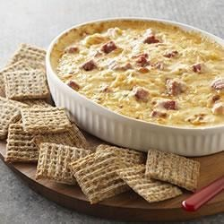 Warm Reuben Spread Recipe - Served as a spread or dip, classic Reuben sandwich ingredients--corned beef, sauerkraut, and Swiss cheese--are baked in a creamy base for a sure-fire party hit.