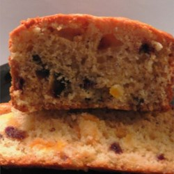 Apricot Cheese Loaf Recipe - Dried apricots and dates pack toothsome richness in this bread that also features cream cheese to balance the sweetness.
