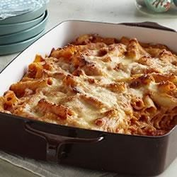Creamy Baked Ziti Recipe - Ziti pasta bakes with layers of creamy tomato sauce and mozzarella cheese in an easy and comforting dish that's ready in less than an hour.