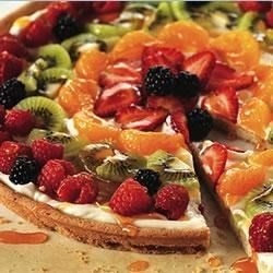 PHILADELPHIA(R) Fruit Pizza Recipe - On a baked cookie 'crust,' arrange sliced kiwi, berries and mandarin orange segments on a creamy layer of 'sauce' for a pretty summer dessert.