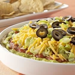 PHILADELPHIA(R) 7-Layer Mexican Dip Recipe - So easy to make and eagerly eaten, this classic layered dip uses spicy cream cheese, guacamole, salsa, cheese, lettuce, and olives for a true crowd pleaser.
