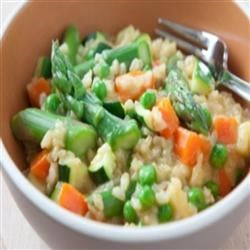 Brown Rice and Vegetable Risotto Recipe - Short-grain brown rice stands in for the usual arborio in this hearty vegetarian risotto, which is worth the wait! Feel free to adapt the recipe according to whatever seasonal produce is available to you.