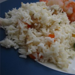 Vegetable Rice Pilaf in the Rice Cooker Recipe - Cooking this pilaf in a rice cooks saves space on your stove for cooking other things. Make this vegetarian by using vegetable bouillon instead.