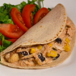 Slow Cooker Santa Fe Chicken Recipe - Canned black beans and corn mingle with prepared salsa and cream cheese with chicken in the slow cooker for a tangy filling for tortillas in this easy meal idea.