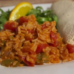 Simple Spanish Rice Recipe - Use diced tomatoes, tomato sauce, and tomato juice in this Spanish-influenced rice side dish.