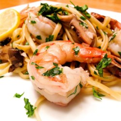 Shrimp Scampi with Pasta Recipe - Shrimp are served with linguine pasta in a white wine-and-butter sauce flecked with fresh parsley for a quick and impressive main dish.