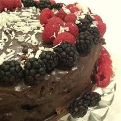 Deep Chocolate Raspberry Cake Recipe - Rich chocolate paired with raspberries--this cake is moist and fudgy. For a special treat, garnish it with fresh raspberries!