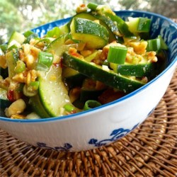 Asian Cucumber and Peanut Salad Recipe - Asian chili-garlic sauce adds sprightly color and a good-sized spicy kick to an easy cucumber salad with peanuts and green onions.