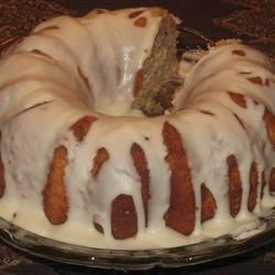 Pear Preserves Cake Recipe - Three spiced layers with pecans and pear preserves, and decorated with caramel frosting.