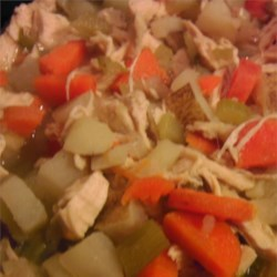 Chicken Stew 'Fricot' Recipe - This recipe for chicken stew with carrots and potatoes is seasoned with summer savory and easily accommodates the addition of dumplings.