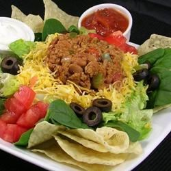 Quick Taco Salad Recipe - Set out bowls of seasoned ground beef, corn chips, and all the fixings and let your guests and family members design their own taco salads at the table. Kids love it.