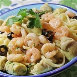 Artichoke and Shrimp Linguine Recipe - Linguine is served with a spicy artichoke and shrimp sautee that is spiced with red pepper flakes for an added kick.