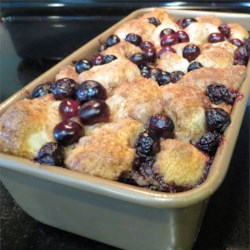 Blueberry Buckle Pull-Apart Bread Recipe - Biscuit dough coated in cinnamon, sugar, and butter is baked with blueberries creating a sweet pull-apart treat perfect for brunches or picnics.