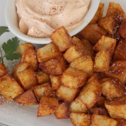 Chef John's Patatas Bravas Recipe - Patatas Bravas is a classic Spanish dish of fried potato cubes served with a spicy dipping sauce. Serve them up as a crowd-pleasing appetizer or side dish.