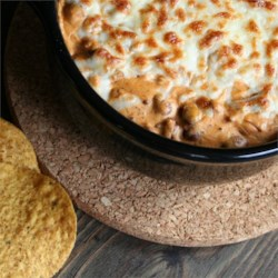 Cheesy Chili Dip II Recipe - Perfect for parties, this chili dip features plenty of melted mozzarella cheese and is great served on chips. Use an additional can of chili, if desired.