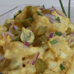 Tangy Potato Salad Recipe - Freshly boiled potatoes and eggs are folded together with a mayonnaise-based dressing loaded with pickles for a tangy and bold potato salad.