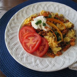 Tortilla Chorizo Scramble Recipe - Brighten up your morning with this scramble featuring pepper jack cheese, pan-crisped chorizo, and tortilla strips.