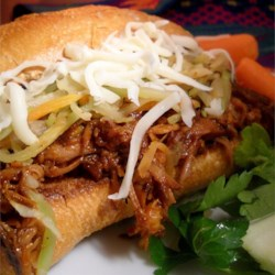 Zesty Pulled Pork Sandwiches Recipe - Tender shredded pork sandwiches are an easy and tasty way to satisfy a crowd without breaking the bank. Serve them on soft hamburger buns or onion rolls.
