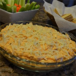 Baked Buffalo Chicken Dip Recipe - Put a new spin on an iconic party favorite with this cheesy, spicy, and tangy Buffalo Chicken Dip. This quick and easy appetizer will be a crowd pleaser. Serve with celery and crackers.