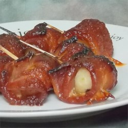 Bacon Wrapped Water Chestnuts I Recipe - Crunchy water chestnuts, smokey bacon and a piquant sauce make these little morsels a treat before dinner. You can easily make enough for a crowd just by increasing the amounts.