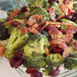 Deli-Style Fresh Broccoli Salad Recipe - Broccoli is tossed with bacon and sweetened dried cranberries before being tossed with a mayonnaise-based dressing for a tasty deli-style salad.