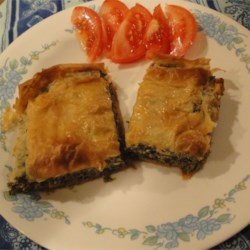 Spinach Pie V Recipe - A rich cheese and spinach mixture is baked inside crisp, rolled pastry sheets. Easy to make, and looks fancy!