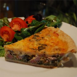 Clark's Quiche Recipe - This recipe is excellent served for breakfast with fruit, or at lunch or dinner with a salad. This recipe makes two 9 inch pies. The reason for this is because if you only make one you will hate yourself the next day when there are no leftovers. Bacon, ham, and spinach and mushrooms are layered with 3 cheeses in this rich delicious egg dish.
