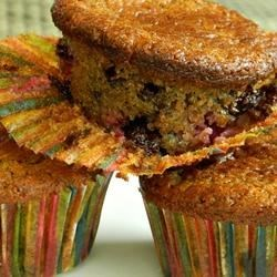 Nutty Raspberry Chocolate Muffins Recipe - Raspberries, banana, almond meal, and dark chocolate chips give muffin batter a colorful and healthier twist that everyone in the family will appreciate.