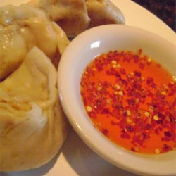 Sweet and Hot Dipping Sauce Recipe - This is a perfect sauce for dipping egg rolls and Chinese dumplings. The sweet, hot, and piquant flavors are nicely balanced.