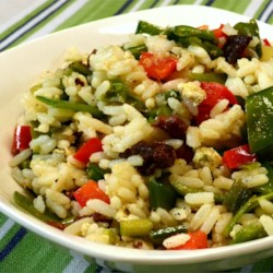 New Year's Fried Rice Recipe - Bacon, red pepper, and green peas add color and flavor to a fried rice dish that makes a great substitute for the same old potatoes.