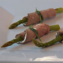 Asparagus Beef Bundles Recipe - Cream cheese spiked with prepared horseradish and asparagus is rolled into slices of roast beef in this fun and tasty appetizer idea.