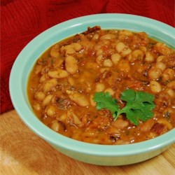 Pinto Beans With Mexican-Style Seasonings Recipe - Hearty, flavorful pinto beans cooked with Mexican-style seasonings make a great side dish, a topping for cornbread, or just a tasty bowl of warming goodness on a cold day. The beans soak all night and simmer for hours until tender. You can simmer them all day if you like.