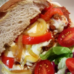 Meatball Grinder Recipe - Meatball grinders are perfect for game day. Tender meatballs are simmered in marinara sauce, then loaded into hoagie rolls and topped with mozzarella cheese.