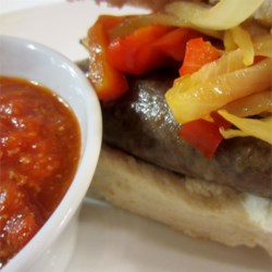 Sausage Grinder Recipe - Cook up a pan of Italian sausages, layer them in hoagie rolls with hot peppers, onions, and cheese for a hearty and satisfying meal.