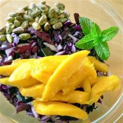 Red Cabbage Mango Pistachio Salad Recipe - A colorful red cabbage salad with fresh mint, roasted pistachio nuts, and mango is tossed with a tangy dressing flavored with truffle oil.