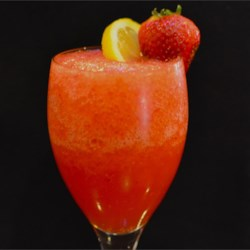 Strawberry Lemonade Slushie Recipe - You can make these refreshingly delightful slushies with just lemonade-flavored drink mix, strawberries, water, and ice.
