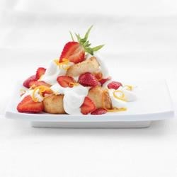 Angel Cake with Strawberries & Citrus Cream Recipe - Naturally luscious whipped cream spiked with fresh-tasting citrus dresses up Angel Food cake and strawberries with ease. Toasting the cake enhances the flavor and texture.