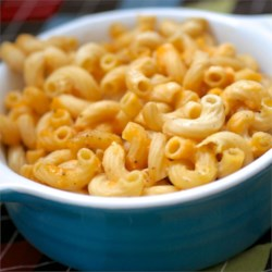 Baked Macaroni and Cheese Recipe and Video - This classic baked macaroni and cheese recipe is easy and delicious. Cheese, butter, milk, and eggs join macaroni noodles in a quick casserole.