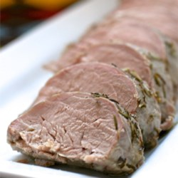 Simple Savory Pork Roast Recipe - Pork loin roast is coated with a simple rosemary-based herb mixture, and roasted to perfection.
